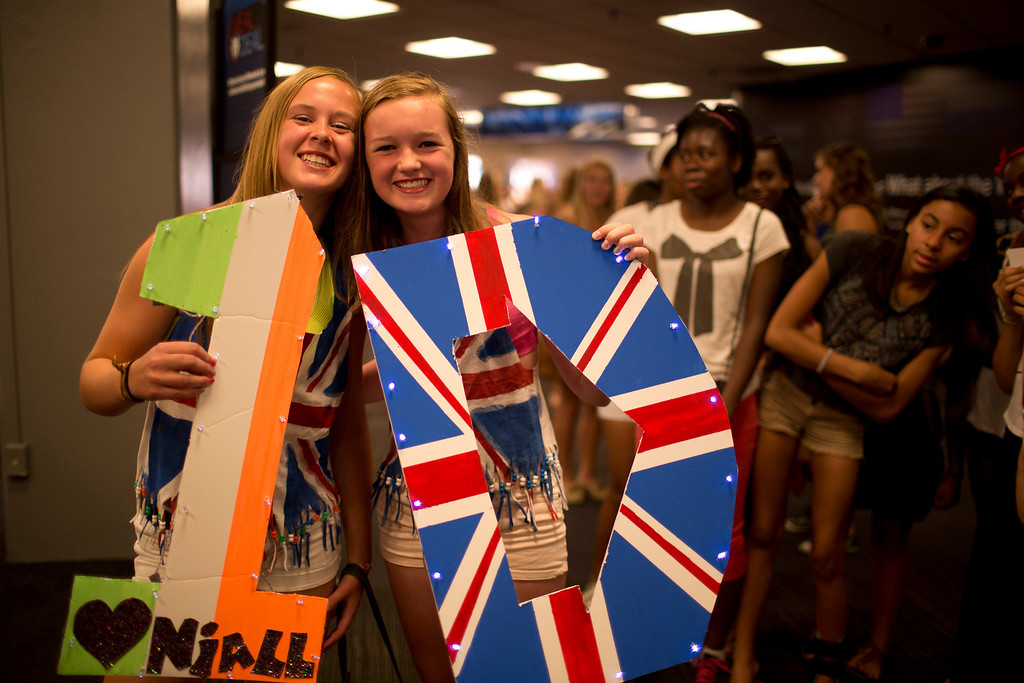 . British boy-band phenomenon One Direction performed at Target Center in Minneapolis Thursday night, July 18, 2013. Molly Sparrow, left, and Molly Myers of Edina waited in the long line to get into Target Center for Thursday night\'s One Direction concert.  (AP Photo/Star Tribune, Jeff Wheeler)