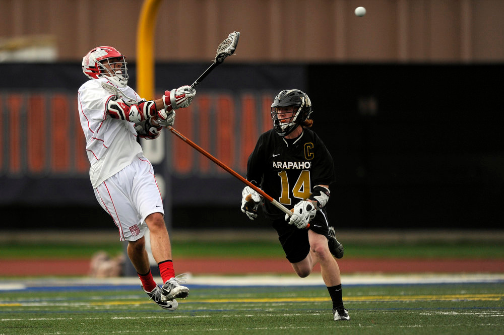 . Regis Jesuit junior midfielder Aaron Horvat #3 passes against Regis Jesuit senior longstick midfielder JD Hall #14 during a CHSAA 5A boys lacrosse semifinal game on May 15, 2013, in Denver, Colorado. Arapahoe won 13-5 to advance to the finals. (Photo by Daniel Petty/The Denver Post)