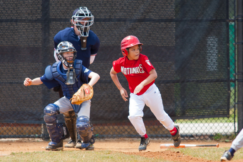 Isaiah fouls the ball up the 3rd base line in the bottom of the 2nd inning. The Nationals almost blew a big lead, but managed to hold off the Rays to win 9-7. They are now 4-2 for the season. 2012 Arlington Little League Baseball, Majors Division. Nationals vs Rays (28 Apr 2012) (Image taken by Patrick R. Kane on 28 Apr 2012 with Canon EOS-1D Mark III at ISO 400, f4.5, 1/1000 sec and 420mm)