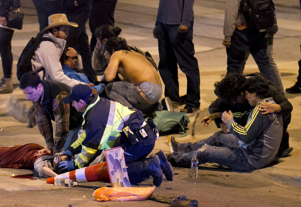 . People are treated after being struck by a vehicle on Red River Street in downtown Austin, Texas, on Wednesday March 12, 2014.  (AP Photo/Austin American-Statesman, Jay Janner)