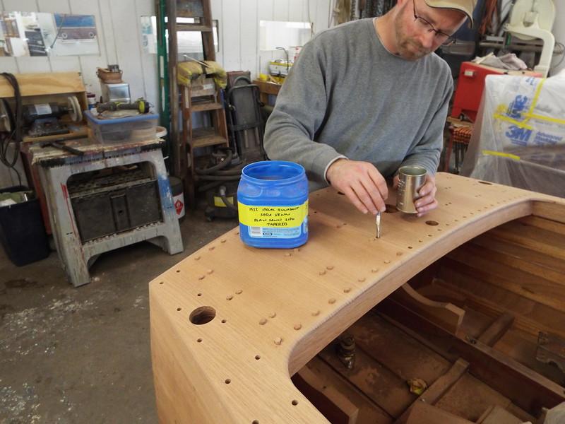 Installing plugs in the rear deck.