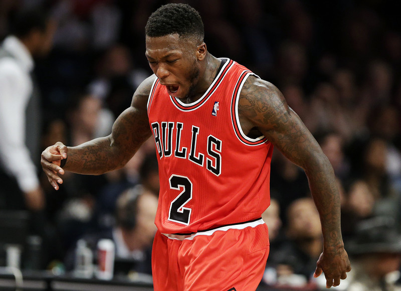 . Chicago Bulls guard Nate Robinson reacts after scoring a 3-point shot against the Brooklyn Nets during the first half in Game 7 of their first-round NBA basketball playoff series in New York, Saturday, May 4, 2013. (AP Photo/Julio Cortez)