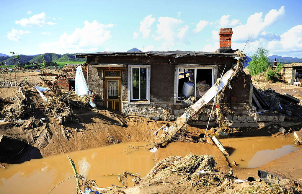 """. A damaged house after floods hit the Qingyuan Manchu autonomous county of Fushun, in northeast China\'s Liaoning province on August 19, 2013. Devastating floods at opposite ends of China have left 105 people dead and another 115 missing in recent days, state media said on August 19. Flooding in the northeast which left 72 people dead was described as \""""the worst in decades\"""" by the state news agency, while another 33 people died in the south as a result of the weather, it said citing the ministry of civil affairs.   AFP PHOTOSTR/AFP/Getty Images"""