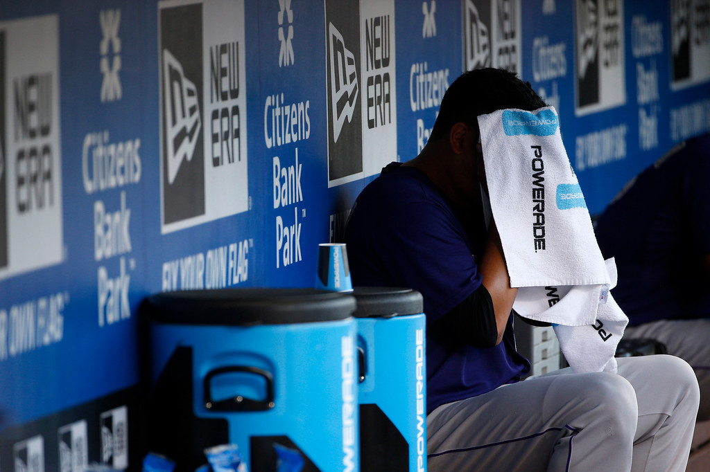 . Colorado Rockies starting pitcher Jhoulys Chacin wipes his face in the dugout after being pulled during the sixth inning of a baseball game against the Philadelphia Phillies, Monday, May 26, 2014, in Philadelphia. Philadelphia won 9-0. (AP Photo/Matt Slocum)