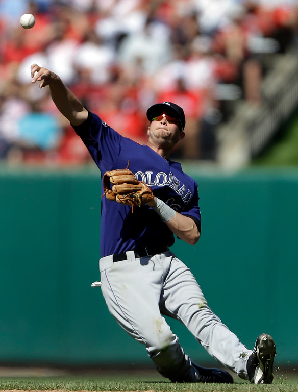 . Colorado Rockies second baseman Reid Brignac tries but fails to throw St. Louis Cardinals\' Jon Jay out at first during the eighth inning of a baseball game Saturday, May 11, 2013, in St. Louis. The Cardinals won 3-0. (AP Photo/Jeff Roberson)