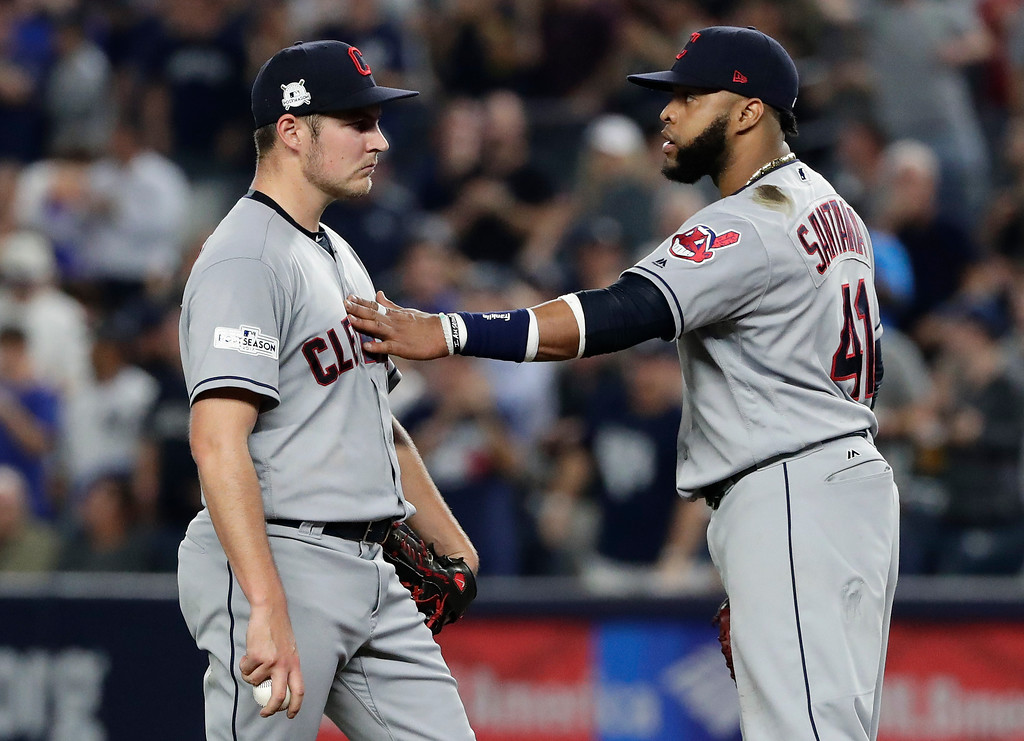 . Cleveland Indians first baseman Carlos Santana (41) talks with pitcher Trevor Bauer during the second inning in Game 4 of baseball\'s American League Division Series against the New York Yankees, Monday, Oct. 9, 2017, in New York. (AP Photo/Frank Franklin II)