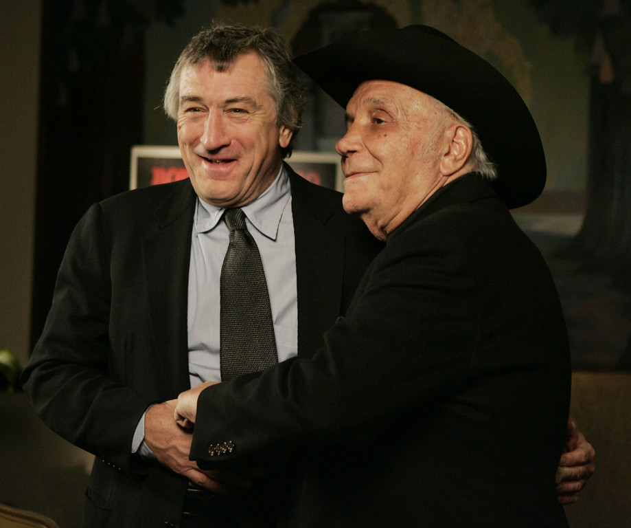 """. FILE - In this Jan. 27, 2005, file photo, Robert DeNiro, left, and boxer Jake LaMotta stand for photographers before watching a 25th anniversary screening of the movie \""""Raging Bull\"""" in New York. LaMotta, whose life was depicted in the film �Raging Bull,� died Tuesday, Sept. 19, 2017, at a Miami-area hospital from complications of pneumonia. He was 95.  (AP Photo/Julie Jacobson, File)"""