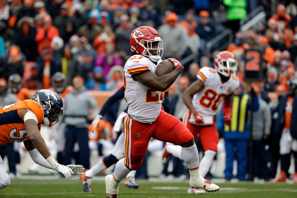 . Kansas City Chiefs running back Kareem Hunt runs for a touchdown against the Denver Broncos during the first half of an NFL football game against the Denver Broncos Sunday, Dec. 31, 2017, in Denver. (AP Photo/Joe Mahoney )