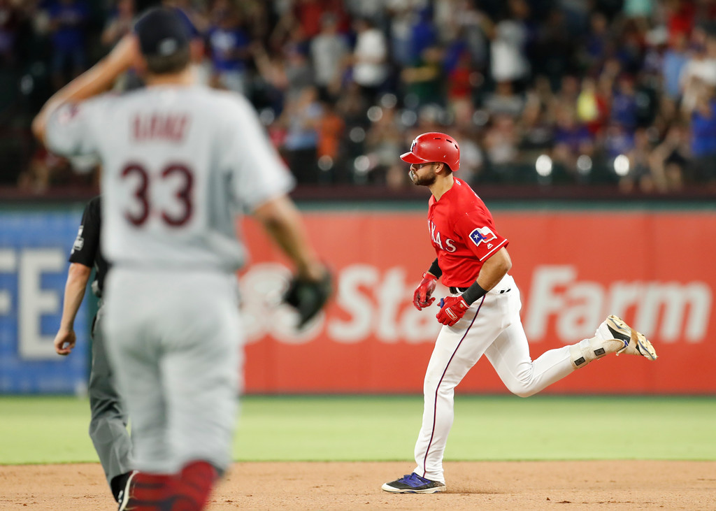 . Texas Rangers\' Joey Gallo, right, rounds the bases on his two-run home run as Cleveland Indians pitcher Brad Hand (33) watches during the seventh inning of a baseball game, Friday, July 20, 2018, in Arlington, Texas. (AP Photo/Jim Cowsert)