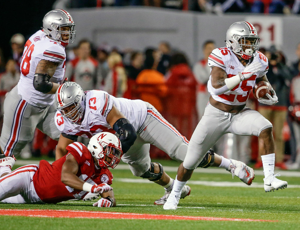 . Ohio State running back Mike Weber (25) carries the ball as offensive lineman Michael Jordan (73) blocks Nebraska linebacker Sedrick King (17) during the first half of an NCAA college football game in Lincoln, Neb., Saturday, Oct. 14, 2017. (AP Photo/Nati Harnik)