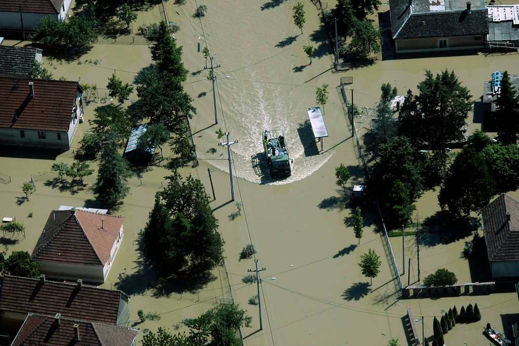 . A flooded area is seen in Obrenovac, some 30 kilometers (18 miles) southwest of Belgrade, Serbia, Monday, May 19, 2014. Belgrade braced for a river surge Monday that threatened to inundate Serbia\'s main power plant and cause major power cuts in the crisis-stricken country as the Balkans struggle with the consequences of the worst flooding in southeastern Europe in more than a century.  (AP Photo)