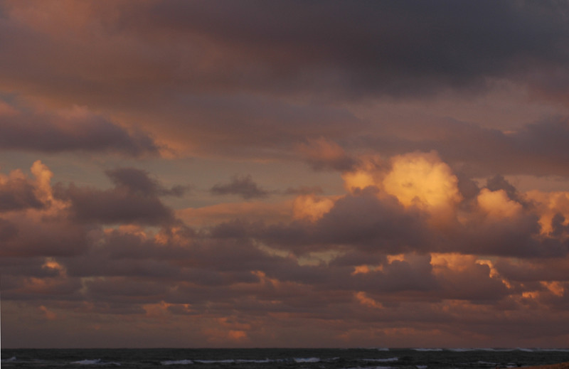 Pink and purple sunset clouds on the North Shore of O'ahu, Hawai'i