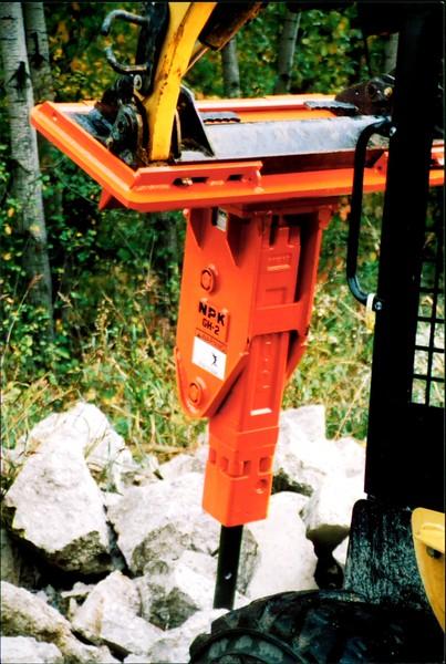 NPK GH2 hydraulic hammer on Cat skidsteer at NPKCE (1).JPG