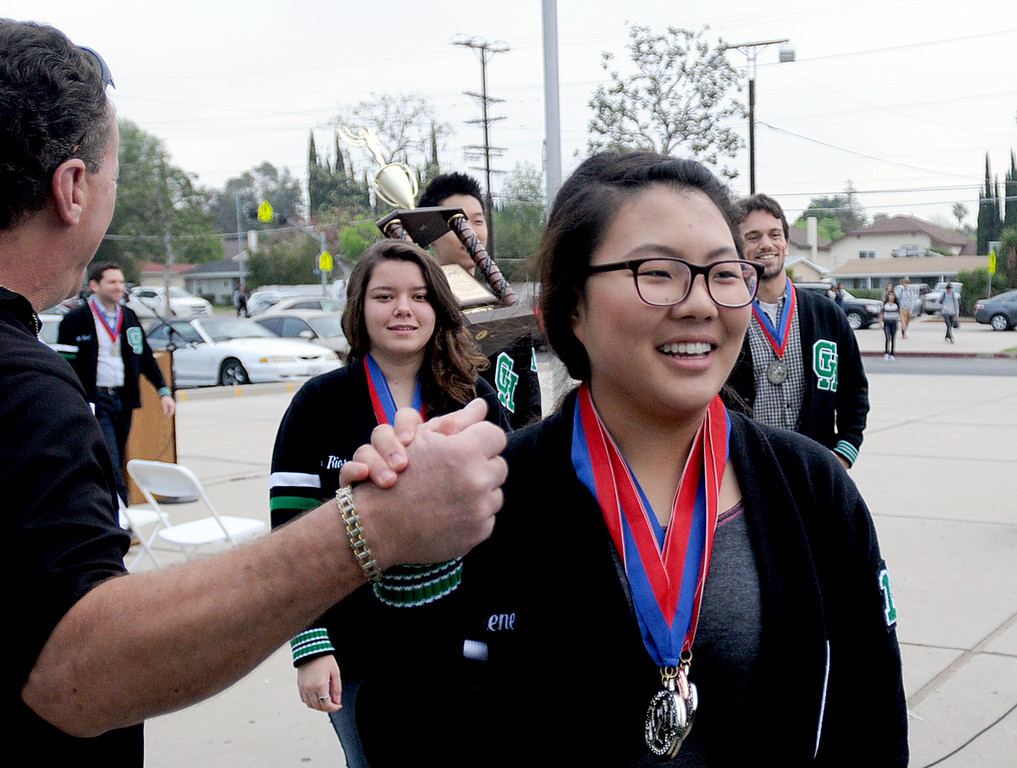 . The Granada Hills Charter High School Academic Decathlon team took second place in the California State Decathlon competition in Sacramento.  El Camino Real Charter High School finished first.  Both teams will travel to Hawaii for the National competition.  The Granada Hills team was greeted with a brief rally and comments from the school\'s Executive Director, Brian Bauer on Monday, March 24, 2014.  Members of the team head back to class after the morning rally.  (Photo by Dean Musgrove/Los Angeles Daily News)