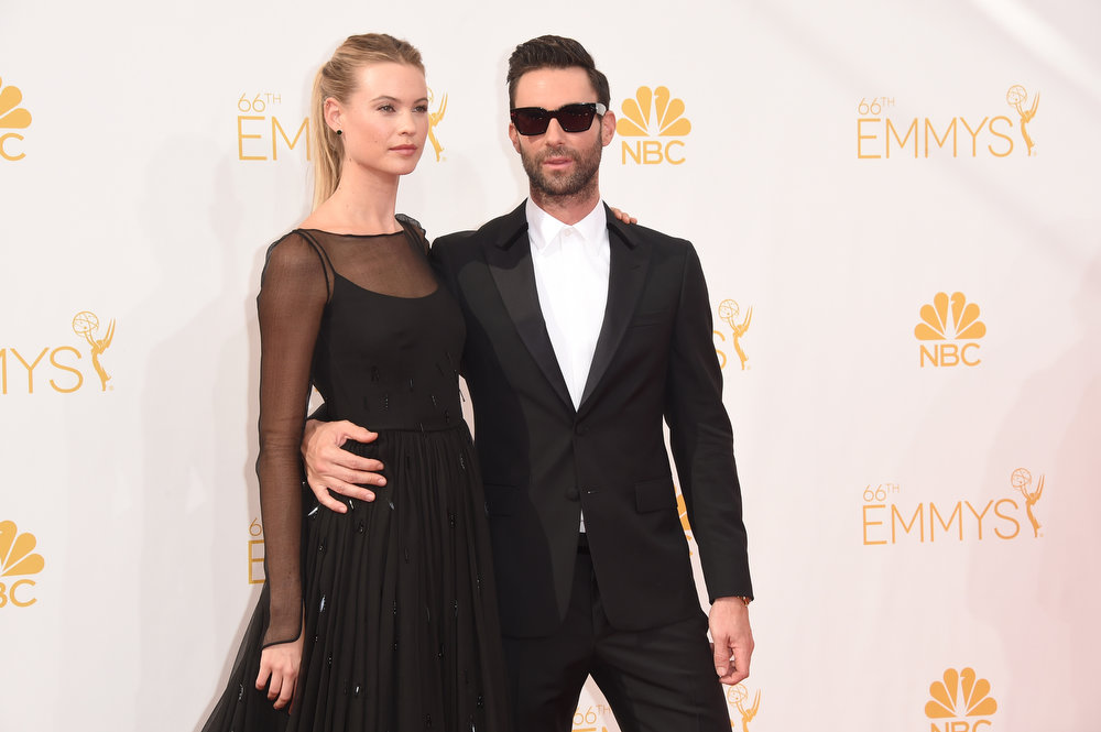 . Model Behati Prinsloo and singer/TV personality Adam Levine attend the 66th Annual Primetime Emmy Awards held at Nokia Theatre L.A. Live on August 25, 2014 in Los Angeles, California.  (Photo by Jason Merritt/Getty Images)