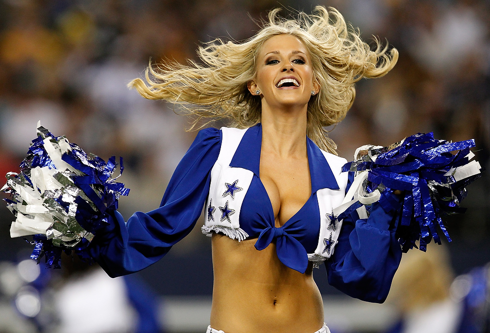 Description of . A Dallas Cowboys Cheerleader performs as the Dallas Cowboys take on the Pittsburgh Steelers at Cowboys Stadium on December 16, 2012 in Arlington, Texas. The Dallas Cowboys beat the Pittsburgh Steelers 27-24. (Photo by Tom Pennington/Getty Images)