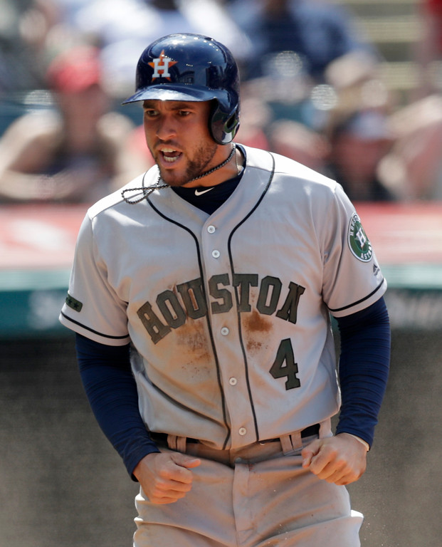 . Houston Astros\' George Springer reacts after scoring in the sixth inning of a baseball game against the Cleveland Indians, Sunday, May 27, 2018, in Cleveland. (AP Photo/Tony Dejak)