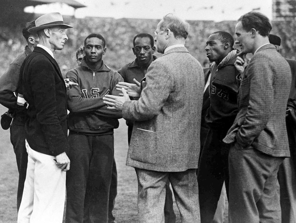 . Following their disqualification in the men\'s Olympic Games 4 x 100metres Relay Final, at Wembley Stadium, London, Aug. 7, 1948, the USA team talk to officials. From left to right; Melvin Patton, hidden behind official; unknown offiical; Lorenzo Wright; Harrison Dillard; Avery Brundage, President of the U.S. Olympic Committee, back to camera;  Barney Ewell; unknown official. (AP Photo)