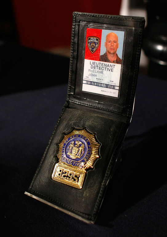 """. WASHINGTON - JUNE 27:  The badge used as a prop by actor Bruce Willis in the \""""Die Hard\"""" series of films is shown at the Smithsonian\'s National Museum of American History June 27, 2007 in Washington, DC. A selection of \""""Die Hard\"""" items will go on display in the new acquisitions case in the museum\'s \""""Treasures of American History\"""" exhibition at the Smithsonian.  (Photo by Win McNamee/Getty Images)"""