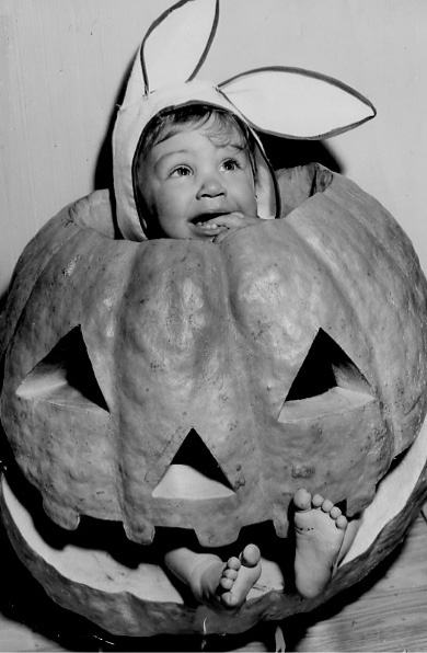 . 1953: Last one: Eric Kruljac, 2, inside a jack-o-lantern that was 67 pounds before carving. (San Jose Mercury)