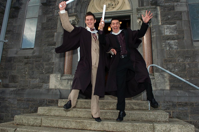 Provision 261006 Clifford Henry (Dublin) and Stephen Goff (Wicklow) jump for joy after graduating with a Bachelor of Business in Recreation and Leisure from WIT yesterday (Weds). PIC Bernie Keating/Provision