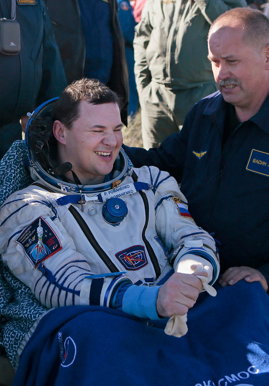 . Russian cosmonaut Roman Romanenko reacts after the landing of the Russian Soyuz space capsule, some 150 km (90 miles) southeast of the town of Zhezkazgan, in central Kazakhstan May 14, 2013.  REUTERS/Mikhail Metzel/Pool