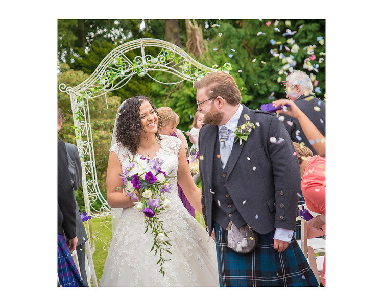 Wedding Photography of Sara & Andrew, Fernie Castle, Cooper, Fife, Photograph is of the Bride & Groom lauging down the aisle