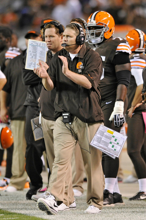 . Cleveland Browns coach Rob Chudzinski cheers from the sidelines in the second quarter of an NFL football game against the Buffalo Bills on Thursday, Oct. 3, 2013, in Cleveland. (AP Photo/David Richard)