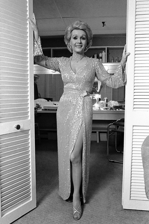 ". Debbie Reynolds, 51, looks magnificent as the struts her stuff in Broadway\'s ""Woman of the Year,\"" March 3, 1983.  Miss Reynolds replaced Raquel Welch and the original star of the long-running hit, Lauren Bacall. Last seen on stage in 1973 in \""Irene,\"" Miss Reynolds was delighted to be back on the stage. (AP Photo/Marty Reichenthal)"
