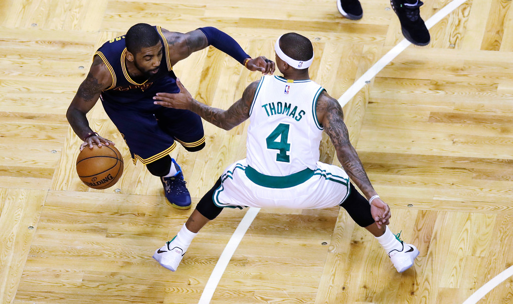 . Cleveland Cavaliers guard Kyrie Irving (2) drives during an NBA basketball game in Boston, Wednesday, March 1, 2017. (AP Photo/Charles Krupa)