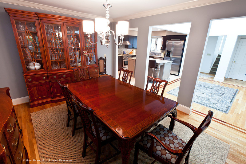 Spacious Dining room, opens to two-story atrium, kitchen and den.