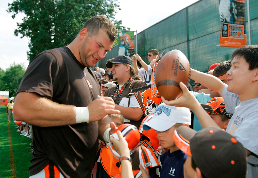 . Cleveland Browns offensive lineman Joe Thomas signs autographs for fans after practice at the team\'s football training camp Friday, July 25, 2008, in Berea, Ohio. (AP Photo/Mark Duncan)