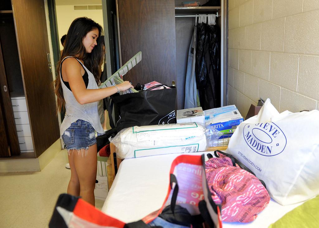 . (John Valenzuela/Staff Photographer) Freshman student Jordan Yorn of San Francisco, unpacks inside her dorm room, Wednesday moring during move-in day at the University of Redlands, August 28, 2013.