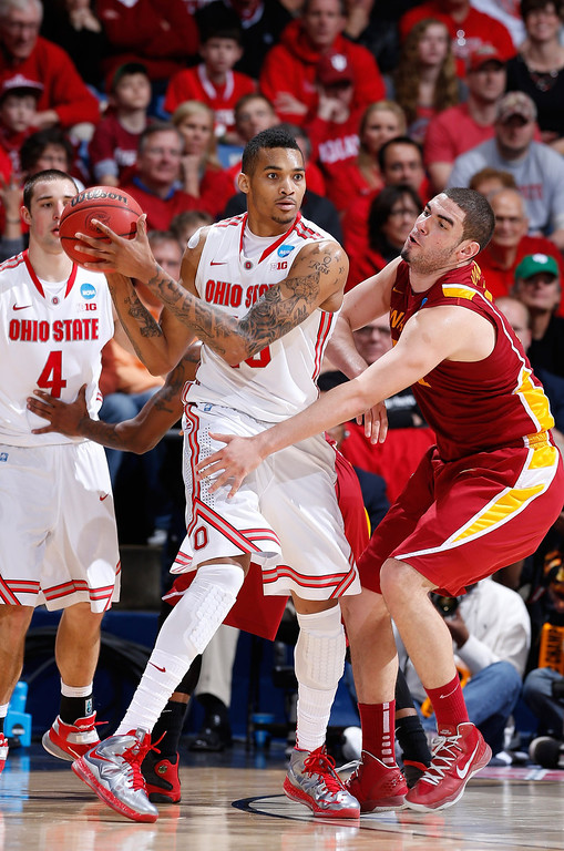 . LaQuinton Ross #10 of the Ohio State Buckeyes handles the ball against Georges Niang #31 of the Iowa State Cyclones in the second half during the third round of the 2013 NCAA Men\'s Basketball Tournament at UD Arena on March 24, 2013 in Dayton, Ohio.  (Photo by Joe Robbins/Getty Images)