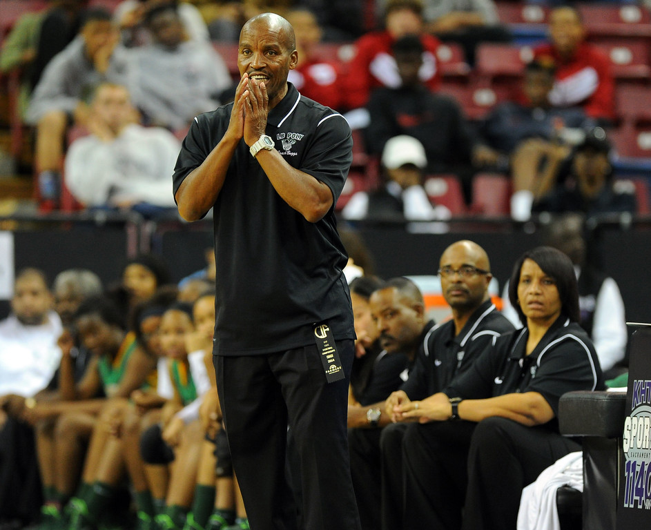 . Poly coach Carl Buggs watches the action at Sleep Train Arena in Sacramento, CA on Saturday, March 29, 2014. Long Beach Poly vs Salesian in the CIF Open Div girls basketball state final. 1st half. (Photo by Scott Varley, Daily Breeze)