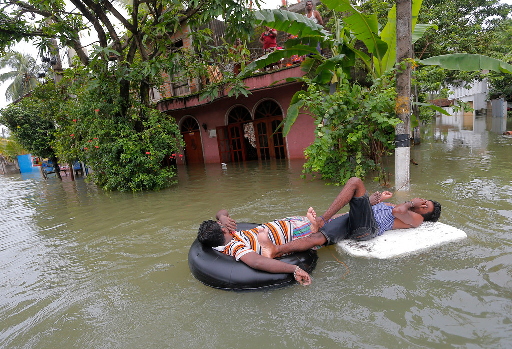 . Sri Lankan flood victims rest on inflatable tubes in Wellampitiya,on the  outskirts of Colombo, Saturday, May 21, 2016. Sri Lanka\'s government on Saturday raised the death toll from landslides and heavy flooding around the island nation to 73, as soldiers continued searching for scores of people missing since deadly landslides struck hill country several days ago. (AP Photo/Eranga Jayawardena)