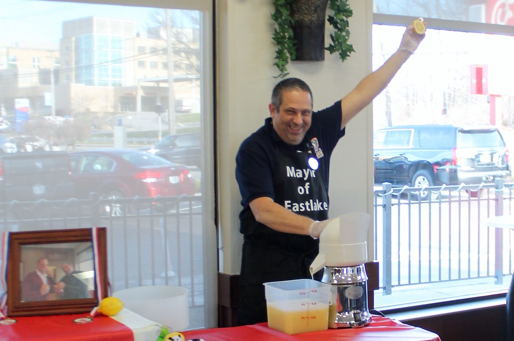 . Kristi Garabrandt � The News-Herald <br> Eastlake Mayor Dennis Morley battles it out in the first annual lemon squeeze competition at Chick-Fil-A Willoughby to raise funds for The Miracle League on March 30, 2017.