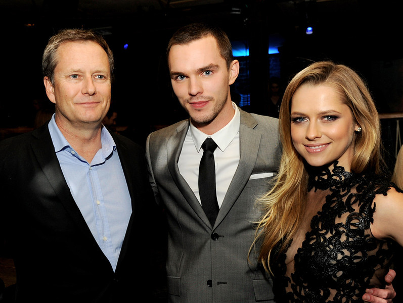 ". Michael Burns (L), Vice Chairman, Lionsgate, actors Nicholas Hoult and Teresa Palmer pose at the after party for the premiere of Summit Entertainment\'s ""Warm Bodies\"" at The Colony on January 29, 2013 in Los Angeles, California.  (Photo by Kevin Winter/Getty Images)"