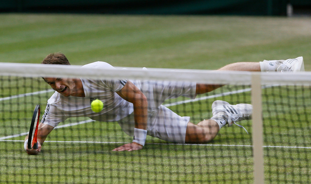 . Andy Murray of Britain tries to play a return to Jerzy Janowicz of Poland during their Men\'s singles semifinal match at the All England Lawn Tennis Championships in Wimbledon, London, Friday, July 5, 2013. (AP Photo/Kirsty Wigglesworth)