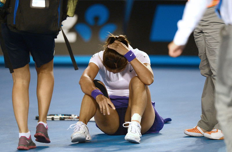 . China\'s Li Na (C) reacts after falling during her women\'s singles final against Belarus\'s Victoria Azarenka on day thirteen of the Australian Open tennis tournament in Melbourne on January 26, 2013. GREG WOOD/AFP/Getty Images