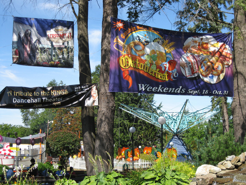 Huge Octoberfest and ScreeemFest banners hang in the park.