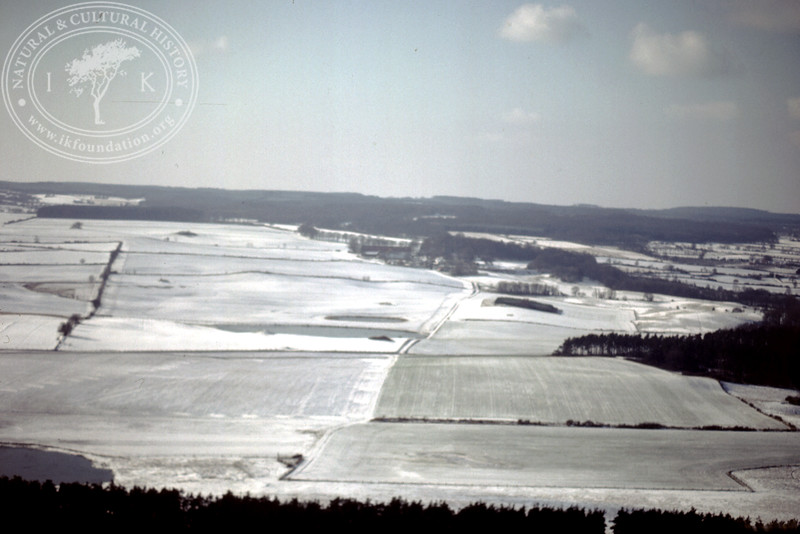 Farmland facing Torups Gård, south Ravlunda, from the east with ponds - with plantations and prehistoric remains (20 February, 1988). | LH.0174