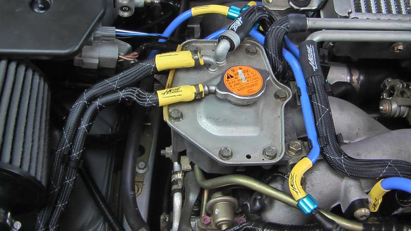 Subaru closeup radiator lines with Hose Candy Diamond Back Skins