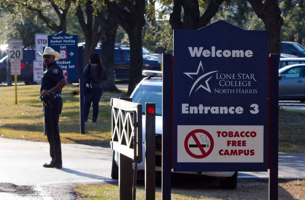 Description of . A sheriff's deputy stands guard at the entrance to Lone Star College North Harris campus in Houston, Texas, January 22, 2013. Shooting broke out between two people on the campus of Lone Star College near Houston on Tuesday and three people were injured, including one of the shooters, police said. REUTERS/Richard Carson