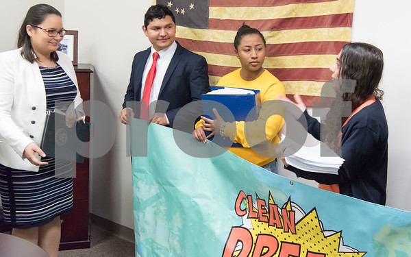 02/22/18 Wesley Bunnell | Staff Activists dropped off over 600 signed letters at office of Congresswoman Elizabeth Esty (CT-5) on Thursday afternoon in support of the Clean Dream Act which seeks to help undocumented immigrant youth. District Director Stephanie Podewell for Congresswoman Esty, L, prepares to accept books containing the over 600 signed letters from CT Students for a Dream's Jonathan Zulez-Cruz and Andrea Sanchez, middle.