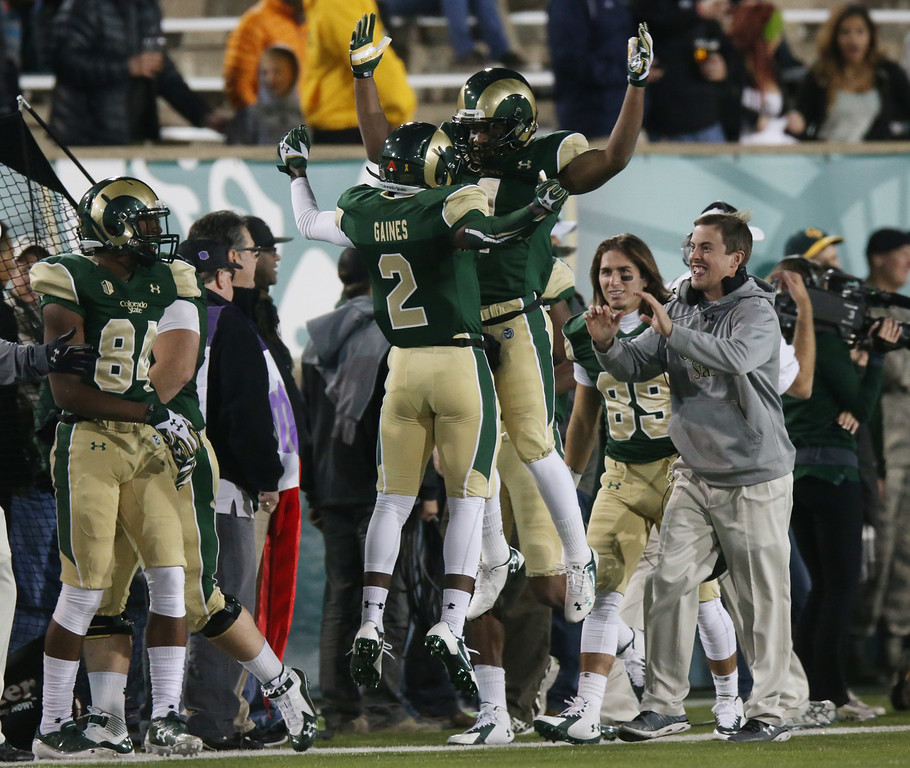 . Colorado State wide receivers Deionte Gaines, left, and Charles Lovett celebrate after Lovett\'s touchdown catch against Hawaii in the first quarter of an NCAA college football game in Fort Collins, Colo., on Saturday, Nov. 8, 2014. (AP Photo/David Zalubowski)