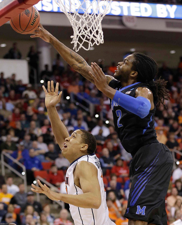 . Memphis forward Shaq Goodwin (2) blocks a shot by Virginia guard Malcolm Brogdon (15) during the first half of an NCAA college basketball third-round tournament game, Sunday, March 23, 2014, in Raleigh. (AP Photo/Gerry Broome)
