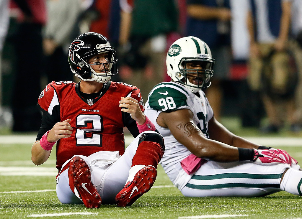 . Quarterback Matt Ryan #2 of the Atlanta Falcons looks on after being tackled by outside linebacker Quinton Coples #98 of the New York Jets during their game at the Georgia Dome on October 7, 2013 in Atlanta, Georgia.  (Photo by Kevin C. Cox/Getty Images)