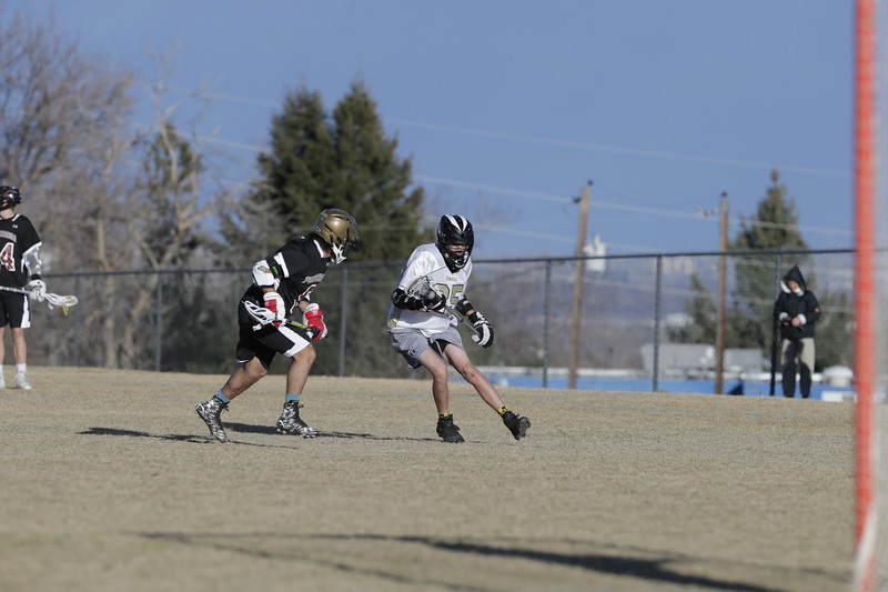 JPM0104-JPM0104-Jonathan first HS lacrosse game March 9th.jpg