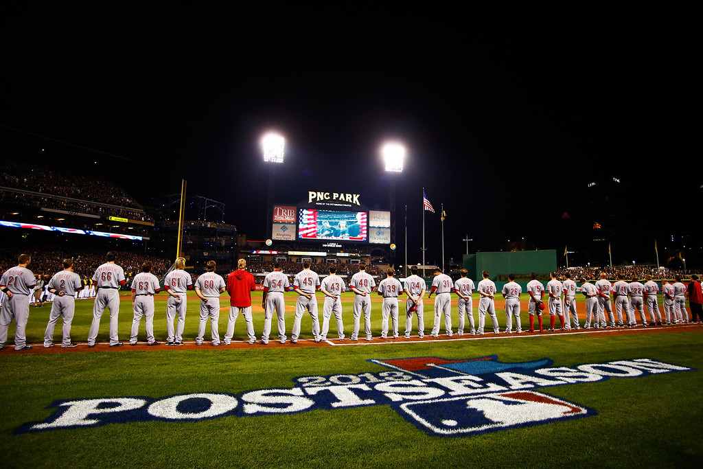 . PITTSBURGH, PA - OCTOBER 01:  Cincinnati Reds players take part in pre-game ceremonies prior to the National League Wild Card game against the Pittsburgh Pirates at PNC Park on October 1, 2013 in Pittsburgh, Pennsylvania.  (Photo by Justin K. Aller/Getty Images)